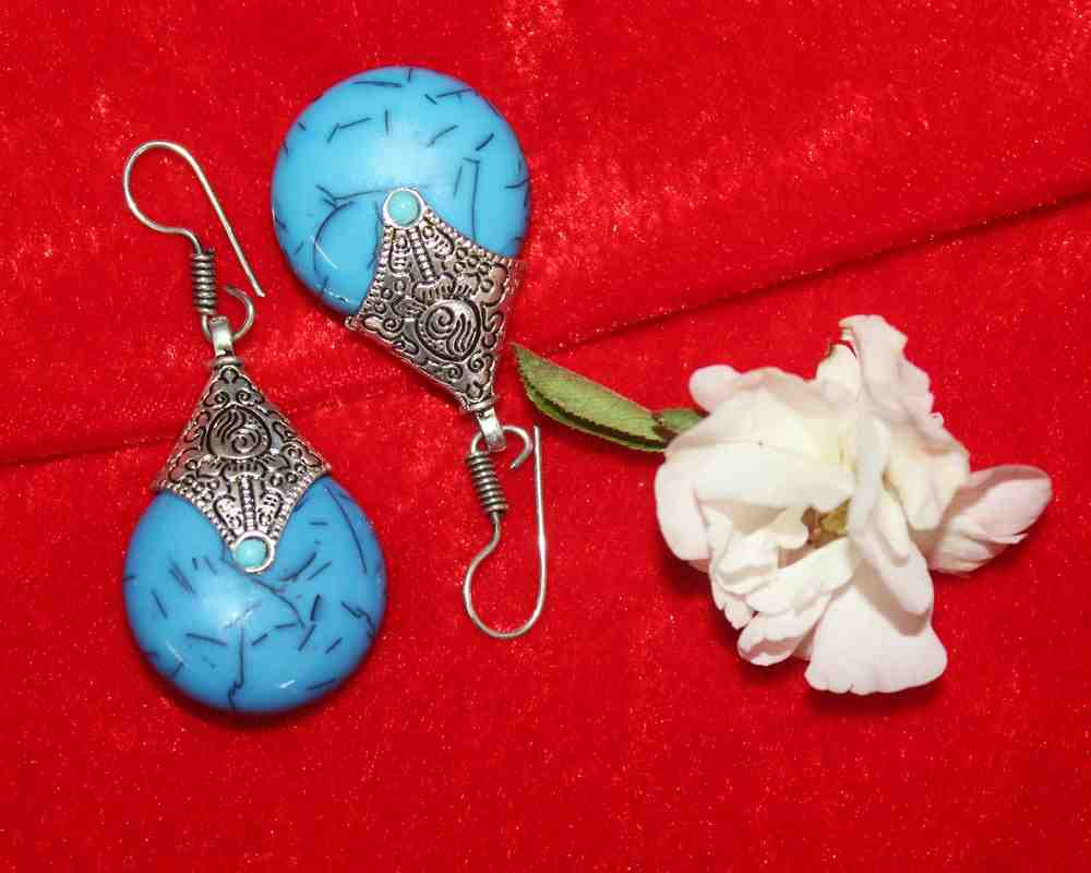 Silver Coated Dangle Light Blue Stone Earrings